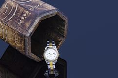 Wooden box and a watch reflection on dark background Stock Photos