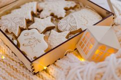 A wooden box with white lace cakes Royalty Free Stock Images