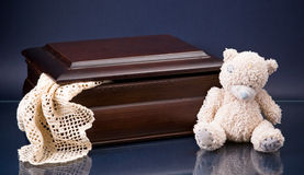 Wooden box and white teddy-bear on blue Stock Images