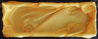 Wooden Box With Yellow Silk In Royalty Free Stock Photos