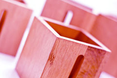 Wooden boxes. A closeup of wooden boxes with slots or slits that appear to have been given a rose or reddish stain Royalty Free Stock Photos