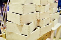 Wooden boxes in carpenter workshop Royalty Free Stock Photos