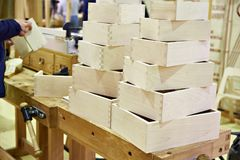 Wooden boxes in carpenter workshop Stock Photography