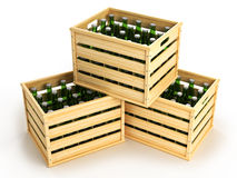 Wooden boxes with green beer bottles. Royalty Free Stock Photography