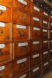 Wooden boxes for medicines in the old pharmacy Royalty Free Stock Photos
