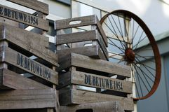 Wooden boxes and an old wheel. royalty free stock images