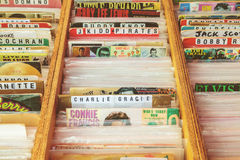 Wooden boxes with vinyl turntable records on a flea market Stock Image