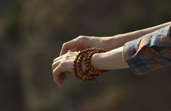 Wooden bracelet on the female hand. stock image