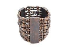 Wooden bracelet isolated on white. Beautiful wooden bracelet isolated on white Stock Photo