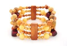 Wooden bracelet isolated on white. Beautiful wooden bracelet isolated on white Royalty Free Stock Images