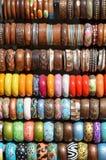 Wooden bracelets on a street market Stock Photography