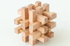 Wooden Brain Teaser on White Background Stock Photo