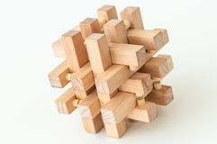 Wooden Brain Teaser on White Background Royalty Free Stock Images
