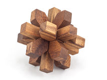 Wooden brainteaser. Puzzle of the wooden blocks on a white background Royalty Free Stock Photo