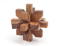 Wooden brainteaser. Puzzle of the wooden blocks on a white background Stock Photography