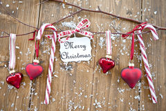 Wooden branches with christmas ornaments and candy Royalty Free Stock Photo