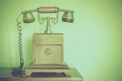 Wooden and brass antique telephone Stock Photography