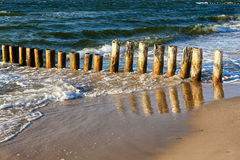 Wooden breakwater Stock Image