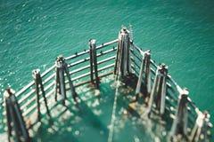 Wooden Breakwater at Coastline Royalty Free Stock Photos