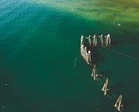 Wooden Breakwater at Coastline Stock Image