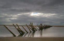 Wooden breakwater Stock Photo