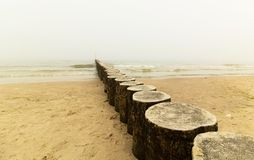 Wooden breakwater, sea in the fog Royalty Free Stock Photography