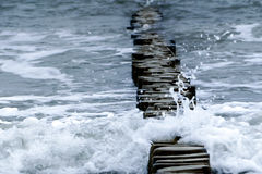 Wooden breakwater and waves at Baltic Sea, copy space Stock Photography