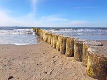 Wooden breakwaters (groynes) in the baltic coast. Wooden breakwaters (groynes) in the german baltic beach coast stock photography