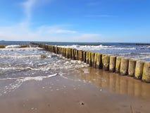 Wooden breakwaters (groynes) in the baltic coast. Wooden breakwaters (groynes) in the german baltic beach coast stock photo