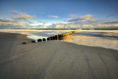 Wooden breakwaters line to the world war II torpedo platform at Baltic Sea Royalty Free Stock Image