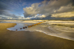 Wooden breakwaters line to the world war II torpedo platform at Baltic Sea Stock Photos