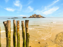 Wooden breakwaters in low tide and Fort National Stock Photos