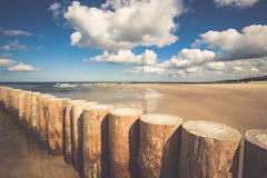 Wooden breakwaters on sandy Leba beach in late afternoon, Baltic Stock Photography