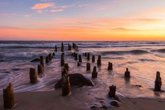 Wooden breakwaters and sea Royalty Free Stock Photo