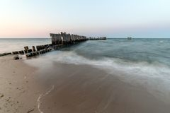 Wooden breakwaters on the sea shore.  royalty free stock images