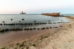Wooden breakwaters on the sea shore.  stock image