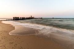 Wooden breakwaters on the sea shore.  royalty free stock photos