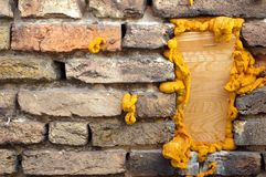 Wooden Brick. Funny wooden brick in the wall Stock Photos