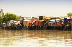 Wooden and brick homes south Vietnam. Wooden and brick homes along the Mekong River in South Vietnam on a sunny day Royalty Free Stock Photo