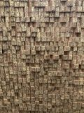 Wooden bricks as a background from production. Uneven monochrome wooden bricks as a background stocked on production stock photos