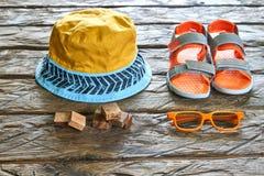 Wooden bricks, hat, sandal, sunglasses. Hat,sandal,sunglasses wooden bricks on wood background, summer concept Stock Photo