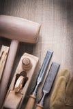 Wooden bricks mallet shaving plane firmer chisels leather gloves Stock Photo