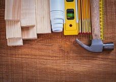 Wooden bricks and meter blueprints ruler hammer Royalty Free Stock Image