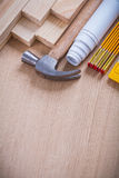 Wooden bricks and meter hammer construction plans Stock Image