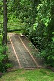 Wooden Bridge. A wooden bridge crosses a small stream to a farm in the Amish country of Ohio Stock Photo