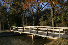 Wooden Bridge. With fall foliage in the background Stock Photography