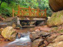 Wooden bridge. Over the mountain river Stock Images