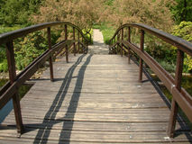 Wooden bridge. Standing on a wooden bridge in a garden on a sunny day Stock Images