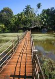 Wooden bridge. Across the river Royalty Free Stock Images