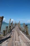 Wooden bridge. The sea a old wooden bridge Stock Photography